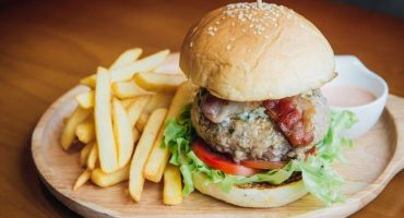 Spicy Pork Burger 200 gr. Ground pork tenderloin, caramelized onions, tomatoes, lettuce and bacon