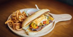 """Philadelphia Steak – Thin Slice dry-aged beef, confit onion, green and red bell peppers with sharp American cheese"""""""